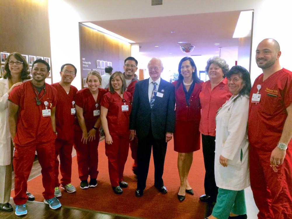 Nurses Wearing Red Scrubs With Betty Porto